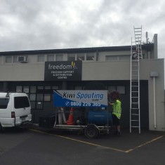spouting cleaning1 235x235 - Commercial Roofs